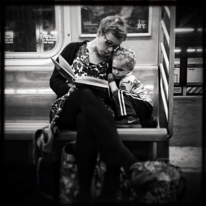 Original caption via Instagram: #pscommute 5:15 PM on the C Train. 34th Street, Penn Station back home to Fort Greene, Brooklyn. Giving the gift of reading. A magical moment between mother and son. It may seem like just another subway ride, but with a book and an imagination, the adventures are limitless. (Jabali Sawicki/@jsawicki1/Instagram)