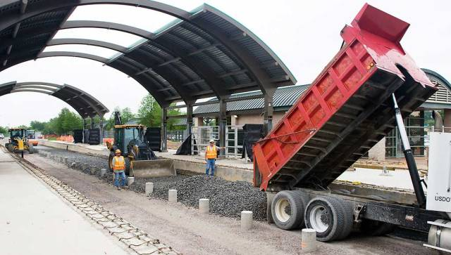 A truck dumps gravel during construction of Lake June Station on May 1, 2009.