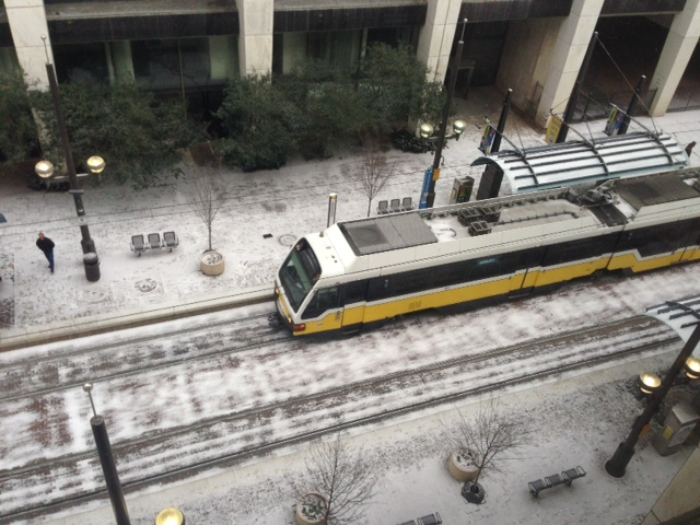 A train rolls into Akard Station in downtown Dallas.