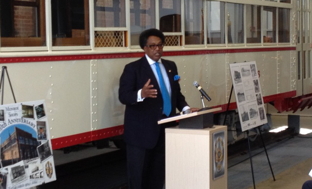Dallas City Councilmember Dwaine Caraway speaks at the Monroe Shops ceremony.