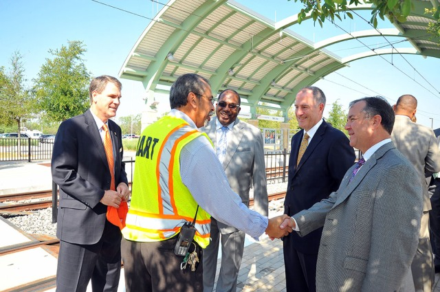 DART board member Randall Chrisman and other officials are introduced to DART Rail Manager Gonzalo Briones.