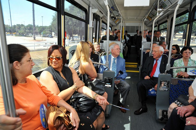 Luncheon attendees ride a bus from DFW Airport Station to the location of the luncheon.
