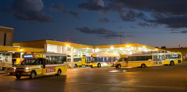 Various DART buses prepare to depart for service in the early service hours.