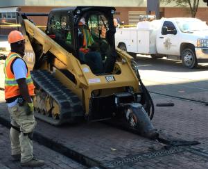 A machine works to remove track in downtown Dallas.