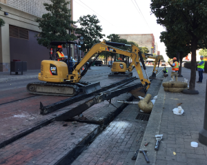 Old rail is removed out of the ground in downtown Dallas.