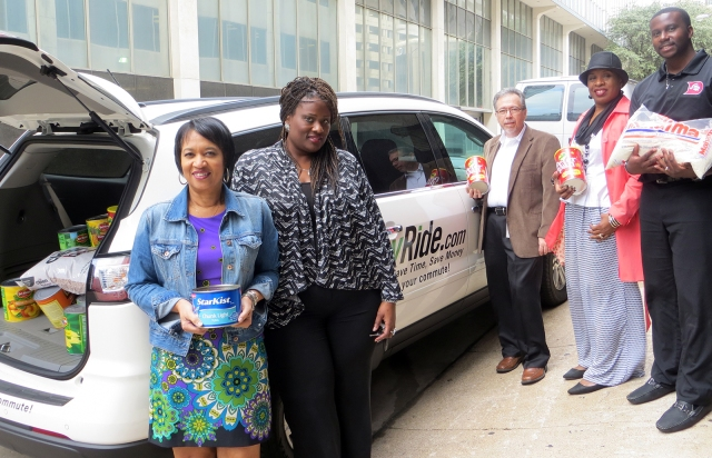 DART employees receive food donations from vRide representatives outside DART headquarters in Downtown Dallas.