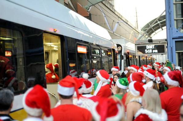 Santas pack onto a DART train at Mockingbird Station. (Credit: Alexandria Olivia / Dallas Morning News)