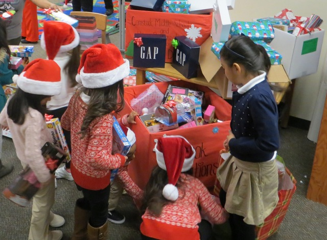 Henry B. Gonzalez Elementary School students fill boxes with toys to be loaded onto a DART bus and delivered to Jonathan's Place.