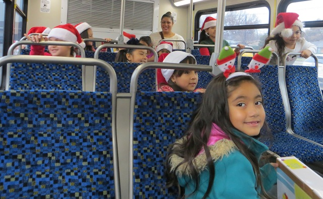 Henry B. Gonzalez Elementary School students help load up a DART bus with toys and books for Jonathan's Place.