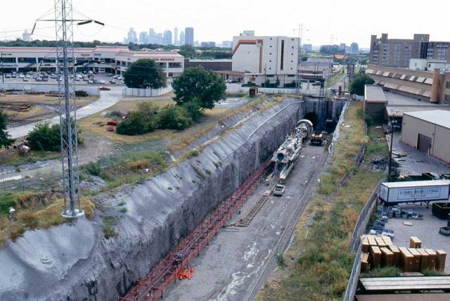 Looking south from Mockingbird Station, the tunnel boring machine is used to drill the twin tunnels under North Central Expressway. Mockingbird Station opened for customer service in January 1997. Cityplace Station, between Pearl/Arts District and Mockingbird, opened in December 2000.