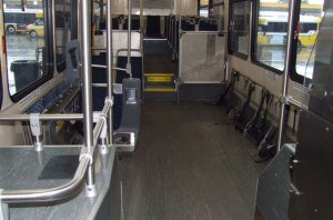The modified 40-foot NABI buses have seats removed and wheelchair harnesses added.