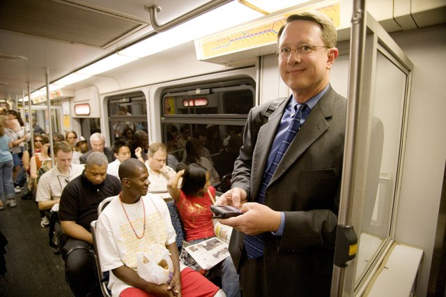 DART President and Executive Director Gary Thomas rides on a DART train in November 2011.