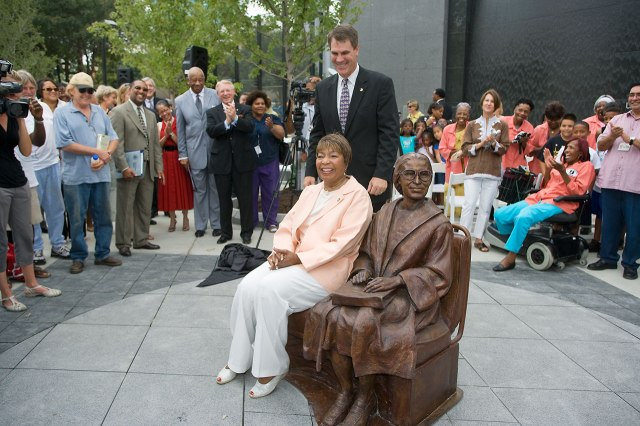Rep. Eddie Bernice Johnson sits with the Rosa Parks statue at the Rosa Parks Plaza unveiling in July 2009.