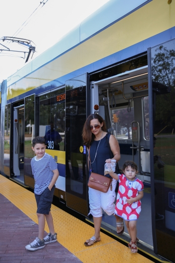 family exiting streetcar