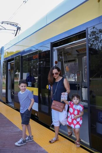 family exiting streetcar