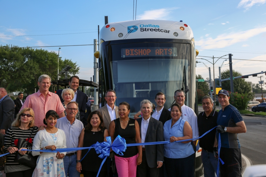Ribbon cutting in front streetcar