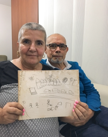 In September 2017, Zapata's mother and father sit in their home in El Peñol, a town close to Medellín, Colombia where Zapata grew up. Zapata's mother holds a drawing Zapata submitted for an art contest when he was 3 and a half years old. Photos by Gustavo Zapata.