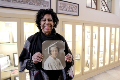 Bettye Morgan, Booker T. Washington Technical High School class of 1956, holds a photo of her mother, who graduated from the school in 1936.