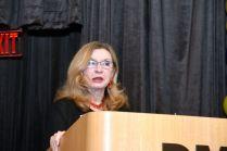 Sue Bauman at podium (2)
