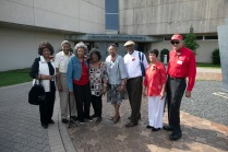 Eight Booker T. Washington High School graduates of the class of 1949 lined up to pose for a picture in front of Dallas' African American Museum June 3, 2019.