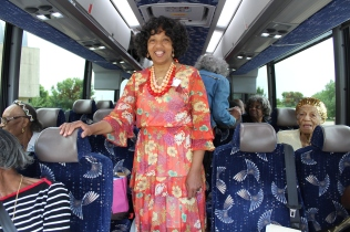 Valencia Yarbrough stands in a tour bus at Fair Park June 3, 2019. Yarbrough lead the 70th high school reunion tour for graduates of Booker T. Washington's class of 1949, which included Yarbrough mother.